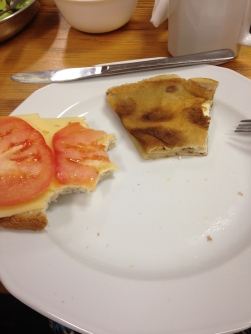 "So many people have asked about food... the bread, butter, cheese and tomato sandwich is very common. You can also see my partially eaten ""Polish pancake"""