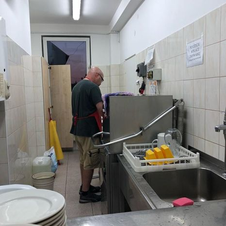 Ben in the dish pit about an hour after we arrived at Ostróda Camp after about 30 hours of travel. Crazy guy.
